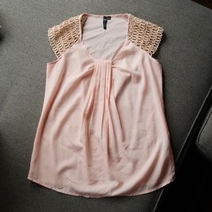 Pink blouse with shoulder detail